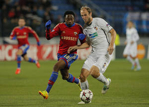 Photo - Viktoria Plzen's Roman Hubnik, right, and Moscow's Ahmed Musa fight for the ball during the UEFA Champions League group D soccer match between CSKA Moscow and Viktoria Plzen, at Petrovsky stadium, in St.Petersburg, Russia, Wednesday, Oct. 2, 2013. (AP Photo/Dmitry Lovetsky)