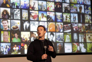 photo - FILE - In this Tuesday, Jan. 15, 2013, file photo, Facebook CEO Mark Zuckerberg speaks at Facebook headquarters in Menlo Park, Calif. Facebook reports fourth-quarter earnings on Wednesday, Jan. 30, 2013. (AP Photo/Jeff Chiu, File)