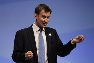 Photo -   FILE - In this Monday Oct. 3, 2011 file photo Jeremy Hunt, Secretary of Sate for Culture, Olympics, Media and Sport, speaks at Britain's Conservative Party Conference in Manchester, England. (AP Photo/Jon Super, file)