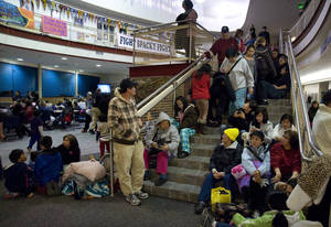 photo - People gather at Sitka High School early Saturday, Jan. 5, 2013, in Sitka, Alaska, following a magnitude 7.5 earthquake and after a subsequent tsunami warning was declared for hundreds of miles of Alaskan and Canadian coastline. The alert was canceled when no damaging waves were generated. (AP Photo/Daily Sitka Sentinel, James Poulson)