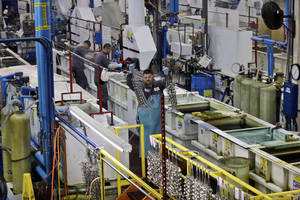Photo - CORRECTS TO LABOR DEPARTMENT FILE - In this Thursday, Oct. 10, 2013, file photo, employees at Sheffield Platers Inc. work on the factory floor in San Diego.  The  labor department estimates U.S. company productivity and costs for the October-December quarter on Thursday, Feb. 6, 2014. (AP Photo/Lenny Ignelzi, File)