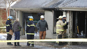 Photo - Firefighters are at the scene of a fatal fire at 2812 Dorchester Drive on Dec. 26, 2012. The fire ripped through the home before dawn Wednesday killing a woman and her four children and leaving one man in critical condition with serious burns, authorities said. Photo by David McDaniel, The Oklahoman Archives.