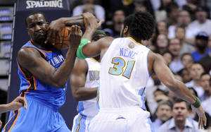 photo - Oklahoma City Thunder center Kendrick Perkins (5) and Denver Nuggets center Nene (31) from Brazil fight for posession during the second quarter of an NBA basketball game Tuesday, April 5, 2011, in Denver. the two were separated by teammates and referees (AP Photo/Jack Dempsey)