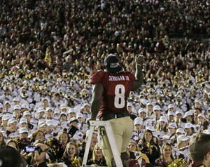 Photo - Florida State's Timmy Jernigan celebrates with fans after the NCAA BCS National Championship college football game against Auburn Monday, Jan. 6, 2014, in Pasadena, Calif. Florida State won 34-31. (AP Photo/Chris Carlson)