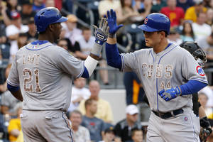 Photo - Chicago Cubs' Anthony Rizzo, right, is greeted by teammate Junior Lake (21) who was on base for his two-run home run off Pittsburgh Pirates starting pitcher Francisco Liriano during the first  inning of a baseball game in Pittsburgh Tuesday, June 10, 2014. (AP Photo/Gene J. Puskar)