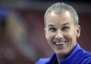 photo - Florida Gulf Coast coach Andy Enfield laughs while talking with broadcasters during practice for a second-round game of the NCAA men's college basketball tournament, Thursday, March 21, 2013, in Philadelphia. Florida Gulf Coast is scheduled to play Georgetown on Friday. (AP Photo/Matt Slocum) ORG XMIT: PXC127