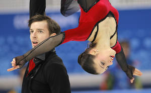 Photo - Stefania Berton and Ondrej Hotarek of Italy compete in the team pairs free skate figure skating competition at the Iceberg Skating Palace during the 2014 Winter Olympics, Saturday, Feb. 8, 2014, in Sochi, Russia. (AP Photo/Vadim Ghirda)