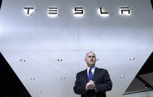 Photo - FILE - In this Jan. 14, 2014, photo, Diarmuid O'Connell, Tesla Vice President, Business Development speaks during media previews at the North American International Auto Show in Detroit. Tesla reports quarterly earnings on Wednesday, Feb. 19, 2014. (AP Photo/Paul Sancya, File)