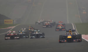 Photo - Red Bull driver Sebastian Vettel of Germany leads the field into turn four during the Indian Formula One Grand Prix at the Buddh International Circuit in Noida, India, Sunday, Oct. 27, 2013. (AP Photo/Saurabh Das)