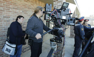 "Photo - Russian writer-director Vladimir Uglichin, left, and his cinematographer Andrea V. Rossotto set up a shot with a 3-D camera during the filming of ""Higher Mission"" a sci-fi movie being shot in Oklahoma City. Photo By Steve Gooch, The Oklahoman <strong>Steve Gooch</strong>"