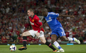 Photo - Manchester United's Wayne Rooney, left, keeps the ball from Chelsea's Ramires during their English Premier League soccer match at Old Trafford Stadium, Manchester, England, Monday Aug. 26, 2013. (AP Photo/Jon Super)