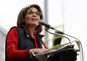 "Photo - FILE - This Oct. 12, 2013 file photo shows former Alaska Gov. Sarah Palin during a rally supporting Steve Lonegan who is running for the vacant New Jersey seat in the U.S. Senate, in New Egypt, N.J. The Sportsman Channel said Monday it has hired Sarah Palin to be host of a weekly outdoors-oriented program that will celebrate the ""red, wild and blue"" lifestyle. The program, ""Amazing America,"" will debut next April. (AP Photo/Julio Cortez, File)"