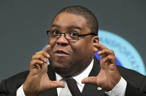 Photo -   NHTSA Administrator David Strickland gestures during a news conference at the Transportation Department in Washington Wednesday, Oct. 10, 2012, to provide consumer safety information regarding counterfeit airbags and what federal officials are doing to address the issue. (AP Photo/Manuel Balce Ceneta)