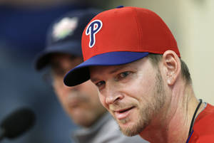 Photo - Philadelphia Phillies pitcher A.J. Burnett speaks during a news conference following a spring training baseball practice on Sunday, Feb. 16, 2014, in Clearwater, Fla. (AP Photo/Charlie Neibergall)