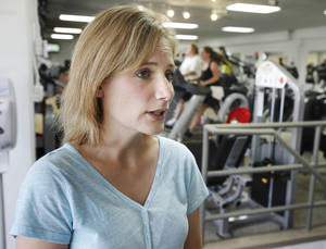 photo - Becca DeBee, who had cancer and went through the YMCA's Livestrong program, works out at the YMCA in Edmond. Photo by Paul Hellstern, The Oklahoman