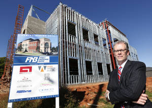 Photo - Mel Martin, president of First National Bank of Oklahoma, poses at the construction site of a new branch opening in May 2014 at 5101 N Western. Photo by Steve Gooch, The Oklahoman <strong>Steve Gooch</strong>