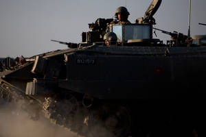 "Photo -   Israeli soldiers ride on top of an armored personal carrier close to the Israel Gaza Border, southern Israel, Thursday, Nov. 15, 2012. Israel's prime minister says the army is prepared for a ""significant widening"" of its operation in the Gaza Strip. Benjamin Netanyahu told reporters on Thursday that Israel has ""made it clear"" it won't tolerate continued rocket fire on its civilians. (AP Photo/Ariel Schalit)"