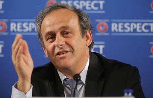 """Photo - FILE - In this Saturday, Feb 22, 2014 file photo UEFA President Michel Platini  speaks during a press conference, one day prior to the UEFA EURO 2016 qualifying draw at the Acropolis Convention Centre in Nice, southeastern France. Seeking to bolster national team football amid the rampant success of club competitions, UEFA's 54 member countries voted Thursday to create the Nations League. UEFA boosted the new event by guaranteeing it would feed into qualifying for the 2020 European Championship. It could later be incorporated into European qualifying for the 2022 World Cup. """"This is a very important decision for the future of football at the level of national teams,"""" UEFA President Michel Platini said Thursday after the unanimous vote at European football's annual congress.. (AP Photo/Lionel Cironneau, File)"""