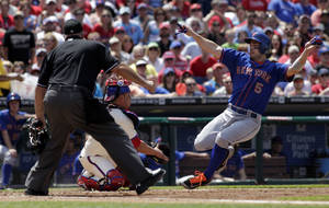 Photo - New York Mets' David Wright (5) scores as Philadelphia Phillies' Carlos Ruiz moves for a late tag in the fourth inning of a baseball game, Sunday, June 1, 2014, in Philadelphia. Home plate umpire Brian O'Nora. (AP Photo/H. Rumph Jr)
