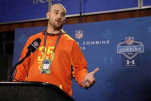 Photo - Oregon offensive lineman Kyle Long answers a question during a news conference at the NFL football scouting combine in Indianapolis, Thursday, Feb. 21, 2013. (AP Photo/Michael Conroy)