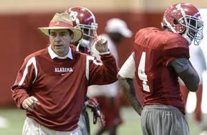 Photo - Alabama head coach Nick Saban runs defensive back practice drills during Alabama's Sugar Bowl preparation football practice, Tuesday, Dec. 17, 2013, at the Hank Crisp Indoor Facility in Tuscaloosa, Ala. (AP Photo/ The Birmingham News, Vasha Hunt)