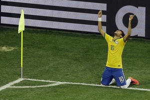Photo - Brazil's Neymar celebrates scoring his side's 2nd goal during the group A World Cup soccer match between Brazil and Croatia, the opening game of the tournament, in the Itaquerao Stadium in Sao Paulo, Brazil, Thursday, June 12, 2014. (AP Photo/Thanassis Stavrakis)