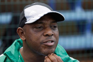 photo - Nigeria's head coach Stephen Keshi talks to journalists before directing a training session Friday, Feb. 8 2013 in Johannesburg. Nigeria will play Burkina Faso in the African Cup of Nations final match Sunday. (AP Photo/Armando Franca)