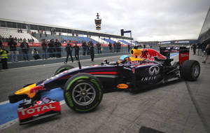 Photo - Infiniti Red Bull Racing driver Sebastian Vettel of Germany exits his garage to drive his new RB10 Formula One car at the Circuito de Jerez on Tuesday, Jan. 28, 2014, in Jerez de la Frontera, Spain. (AP Photo/Miguel Angel Morenatti)