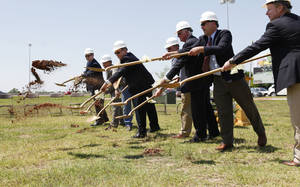 photo - City and mall officials break ground on phase two of The Outlet Shoppes at Oklahoma City. <strong>PAUL HELLSTERN - Oklahoman</strong>