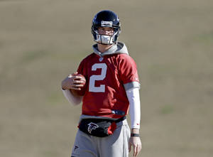 Photo - Atlanta Falcons' Matt Ryan holds a football during NFL football practice at the team's training facility, Friday, Jan. 18, 2013, in Flowery Branch, Ga. The Falcons host the San Francisco 49ers in the NFC championship on Sunday. (AP Photo/David Goldman)