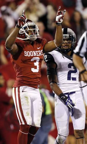 Photo - Oklahoma's Sterling Shepard (3) reacts after a Sooner touchdown in front of TCU 's Jason Verrett (2) during the college football game between the University of Oklahoma Sooners (OU) and the Texas Christian University Horned Frogs (TCU) at the Gaylord Family-Oklahoma Memorial Stadium on Saturday, Oct. 5, 2013 in Norman, Okla.   Photo by Chris Landsberger, The Oklahoman