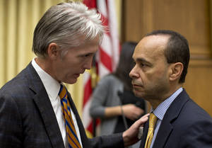 Photo - House Judiciary Committee members Rep. Trey Gowdy, R-S.C., sponsor of the Strengthen and Fortify Enforcement Act, left, talks with Rep. Luis Gutierrez, D-Ill., on Capitol Hill in Washington, Tuesday, June 18, 2013, prior to the start of the committee's hearing to discuss the Strengthen and Fortify Enforcement Act. The committee in the Republican-led House is preparing to cast its first votes on immigration this year, on a tough enforcement-focused measure that Democrats and immigrant groups are protesting loudly. (AP Photo/Carolyn Kaster)