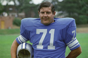 Photo -   FILE - This is a 1971 file photo showing Detroit Lions football player Alex Karras. Karras, who gained fame in the NFL as a fearsome defensive lineman and later as an actor, has died. He was 77. Craig Mitnick, Karras' attorney, said Karras died at home in Los Angeles on Wednesday, Oct. 10, 2012, surrounded by family. (AP Photo/File)