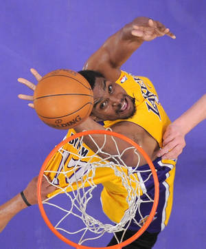 Photo - FILE - In this May 13, 2012 file photo, Los Angeles Lakers center Andrew Bynum puts up a shot during the first half in Game 7 in their first-round NBA basketball playoff series against the Denver Nuggets in Los Angeles. A person with knowledge of the negotiations says the Cleveland Cavaliers have offered free-agent center Andrew Bynum a two-year contract. The Cavs made the offer Monday night, July 8, 2013, a deal that includes a team option for the second year. The person who spoke to the Associated Press on Tuesday did so on condition of anonymity because of the sensitivity of the talks.  (AP Photo/Mark J. Terrill, File)