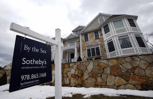 Photo - This March 21, 2014 photo shows a home for sale in North Andover, Mass. Freddie Mac, the mortgage company, releases weekly mortgage rates on Thursday, April 24, 2014. (AP Photo/Elise Amendola)