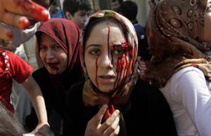 Photo -   Injured Syrian women arrive at a field hospital after an air strike hit their homes in the town of Azaz on the outskirts of Aleppo, Syria, Wednesday, Aug. 15, 2012. (AP Photo/ Khalil Hamra)