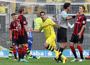 Photo - Dortmund's Henrikh Mkhitaryan of Armenia, center, celebrates his side's second goal during the German first league Bundesliga soccer match between Eintracht Frankfurt and Borussia Dortmund in Frankfurt, Germany, Sunday, Sept. 1, 2013. (AP Photo/Michael Probst)