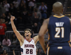 Photo -   Atlanta Hawks' Kyle Korver (26) yells after the Hawks took the lead in the final seconds of an NBA basketball game against the Indiana Pacers on Wednesday, Nov. 7, 2012, in Atlanta. Atlanta won 89-86. (AP Photo/John Bazemore)