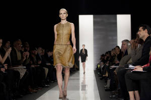 Photo - A model walks the runway during the Ralph Rucci Fall 2013 fashion show during Fashion Week, Sunday, Feb. 10, 2013, in New York. (AP Photo/Karly Domb Sadof)