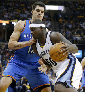 Photo - Oklahoma City's Steven Adams (12) defends Memphis' Zach Randolph (50) during Game 6 in the first round of the NBA playoffs between the Oklahoma City Thunder and the Memphis Grizzlies at FedExForum in Memphis, Tenn., Thursday, May 1, 2014. Oklahoma City won 104-84. PHOTO BY BRYAN TERRY, The Oklahoman