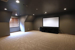 Photo - An entertainment room on the second floor of a home by Huffman Construction at 3509 SW 126 Terrace in the Rockport addition. PHOTO BY PAUL B. SOUTHERLAND, THE OKLAHOMAN <strong>PAUL B. SOUTHERLAND - The Oklahoman</strong>