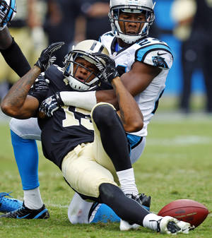 photo -   New Orleans Saints' Joe Morgan (13) reacts as he is hit by Carolina Panthers' Josh Norman (24) after a catch during the third quarter of an NFL football game in Charlotte, N.C., Sunday, Sept. 16, 2012. The pass was ruled incomplete. (AP Photo/Chuck Burton)