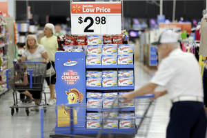 Photo - FILE - In this Friday, July 12, 2013, file photo, customers shop at a Wal-Mart, in Bristol, Pa. The Federal Reserve reports how much consumers borrowed in July on Monday, Sept. 9, 2013. (AP Photo/Matt Rourke, File)