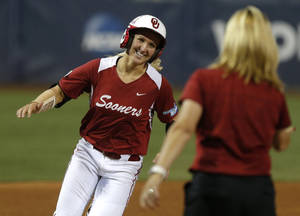 Photo - OU's Shelby Pendley celebrates after hitting a home run in the first inning of a Women's College World Series game between at ASA Hall of Fame Stadium in Oklahoma City Thursday, May 29, 2014. Photo by Bryan Terry, The Oklahoman