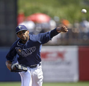 Photo - Tampa Bay Rays starting pitcher David Price pitches in the first inning of an exhibition baseball game against the Minnesota Twins in Port Charlotte, Fla., Tuesday, March 11, 2014. (AP Photo/Gerald Herbert)