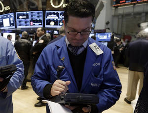 Photo - Trader Leon Montana works on the floor of the New York Stock Exchange Friday, Jan. 31, 2014. Stocks fell sharply in early trading Friday, as investors fretted over disappointing earnings from companies like Amazon.com and more trouble in overseas markets. (AP Photo/Richard Drew)