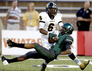 Photo - Edmond Santa Fe's Malik Earl pulls down a pass in front of Midwest City's Elijah Wilson during the high school football game between Edmond Santa Fe and Midwest City at Wantland Stadium in Edmond, Okla., Thursday, Sept. 5, 2013. Photo by Sarah Phipps, The Oklahoman