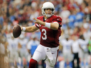 Photo - Arizona Cardinals quarterback Carson Palmer (3) scrambles against the Detroit Lions during the second half of a NFL football game, Sunday, Sept. 15, 2013, in Glendale, Ariz. (AP Photo/Matt York)