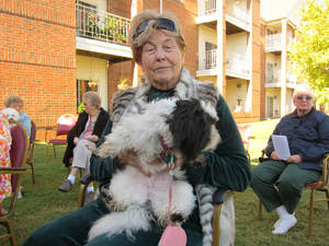 "Photo - Sara ""Sally Harper"" holds her pet Clara Belle, a Shih Tzu, during the Blessing of the Animals service on Thursday (Oct. 17) at Epworth Villa, 14901 N Pennsylvania. <strong>Carla Hinton - The Oklahoman</strong>"