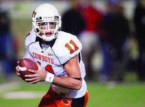Photo - Barring injury, OSU quarterback Zac Robinson will break most of Mike Gundy's passing records this season. AP Archive Photo